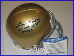 LOU HOLTZ Signed NOTRE DAME Mini-helmet with Beckett COA & Inscription