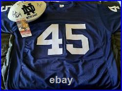Rudy Ruettiger Signed Notre Dame Jersey & Football. JSA COA Ruettiger hologram